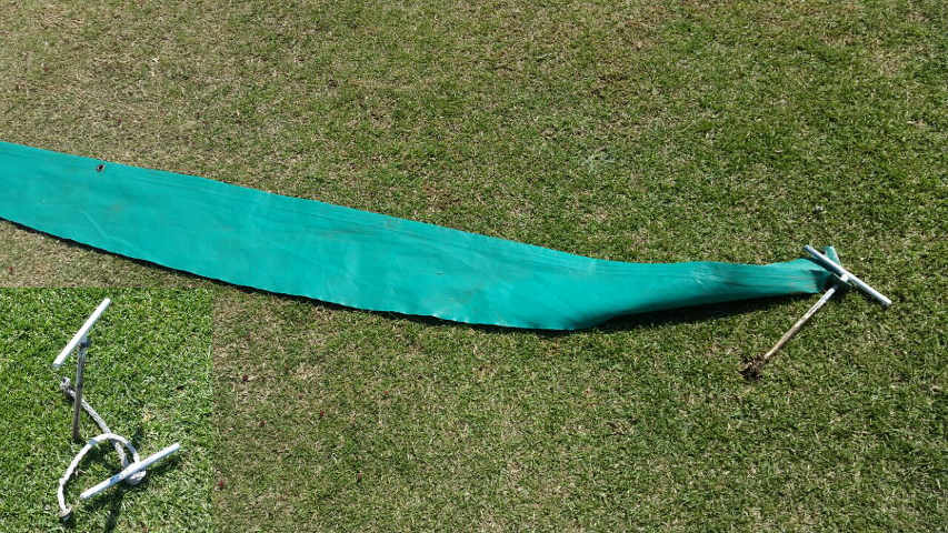 covers damaged by the storm - pegs still in the ground